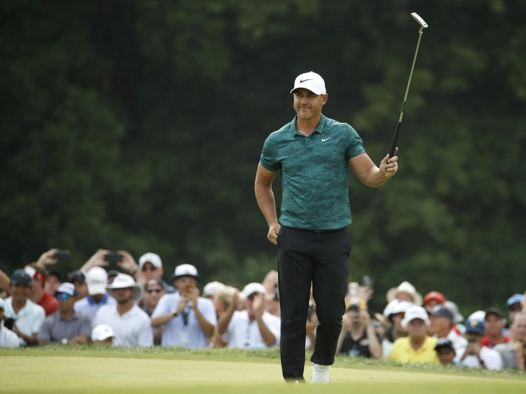 Brooks Koepka is cheered on the 18th green as he wins the PGA Championship golf tournament at Bellerive Country Club, Sunday, Aug. 12, 2018, in St. Lo...