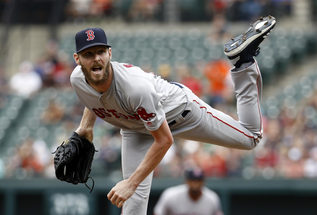 Boston Red Sox starting pitcher Chris Sale follows through on a pitch to the Baltimore Orioles in the first inning of a baseball game, Sunday, Aug. 12