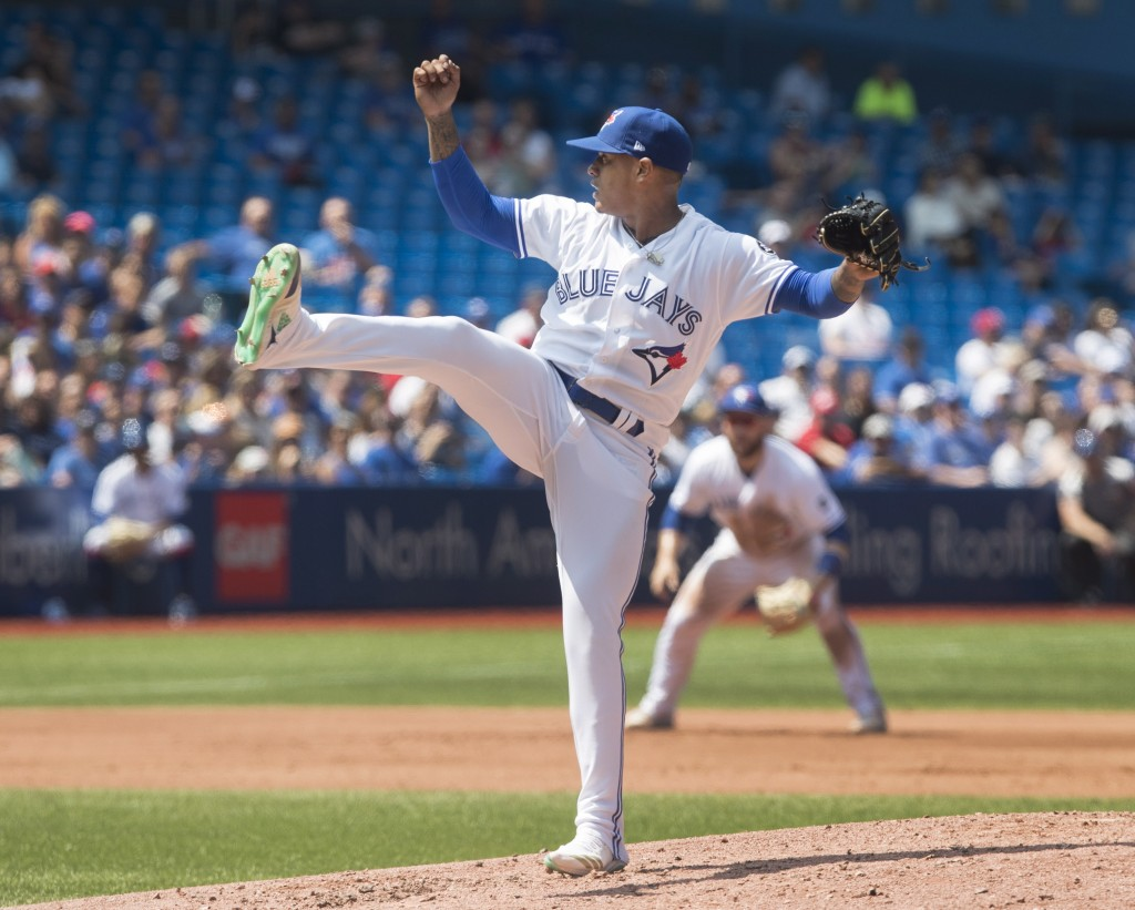 Toronto Blue Jays starting pitcher Marcus Stroman reacts after giving up an RBI single to Tampa Bay Rays Willy Adames in the fourth inning of a baseba