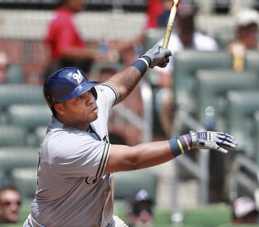 Milwaukee Brewers' Jesus Aguilar hits a three-run home run against the Atlanta Braves Braves during the fourth inning of a baseball game Sunday, Aug.1