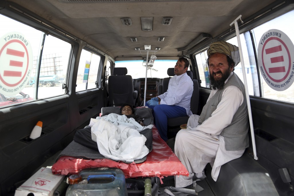 An injured boy rides in an ambulance on the Ghazni highway, in Maidan Shar, west of Kabul, Afghanistan, Monday, Aug. 13, 2018. Afghan forces battled t...