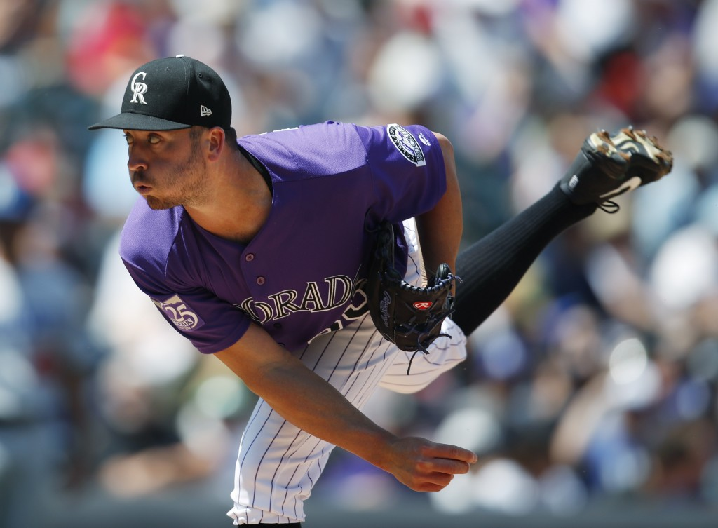 Colorado Rockies starting pitcher Chad Bettis works against the Los Angeles Dodgers in the first inning of a baseball game Sunday, Aug. 12, 2018, in D