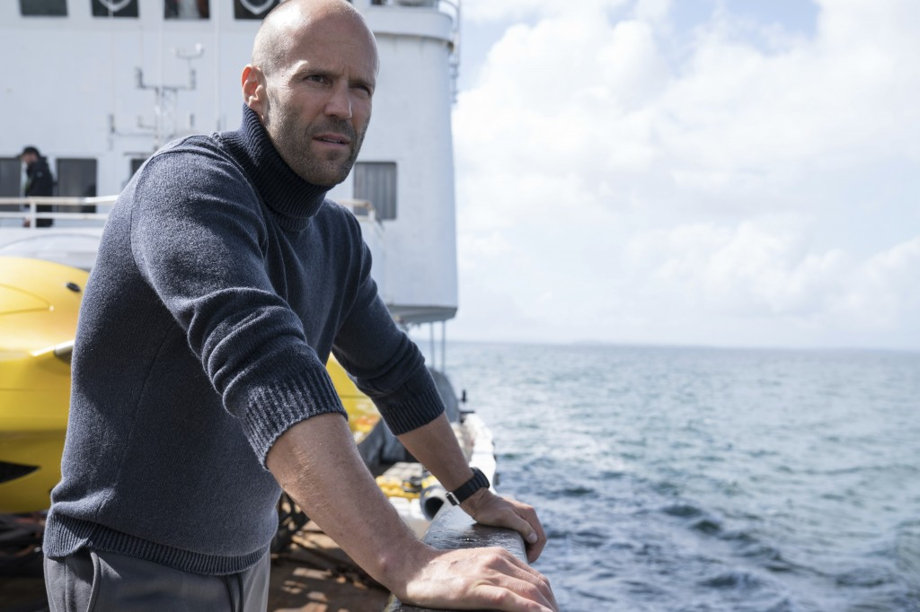 """FILE - This file image released by Warner Bros. Entertainment shows Jason Statham in a scene from the film, """"The Meg."""" The shark thriller """"The Meg"""" be..."""