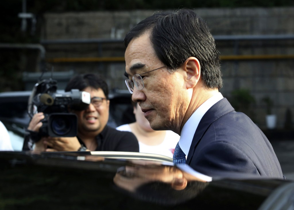 South Korean Unification Minister Cho Myoung-gyon gets into a car to leave for the border village of Panmunjom to attend a meeting between South and N...
