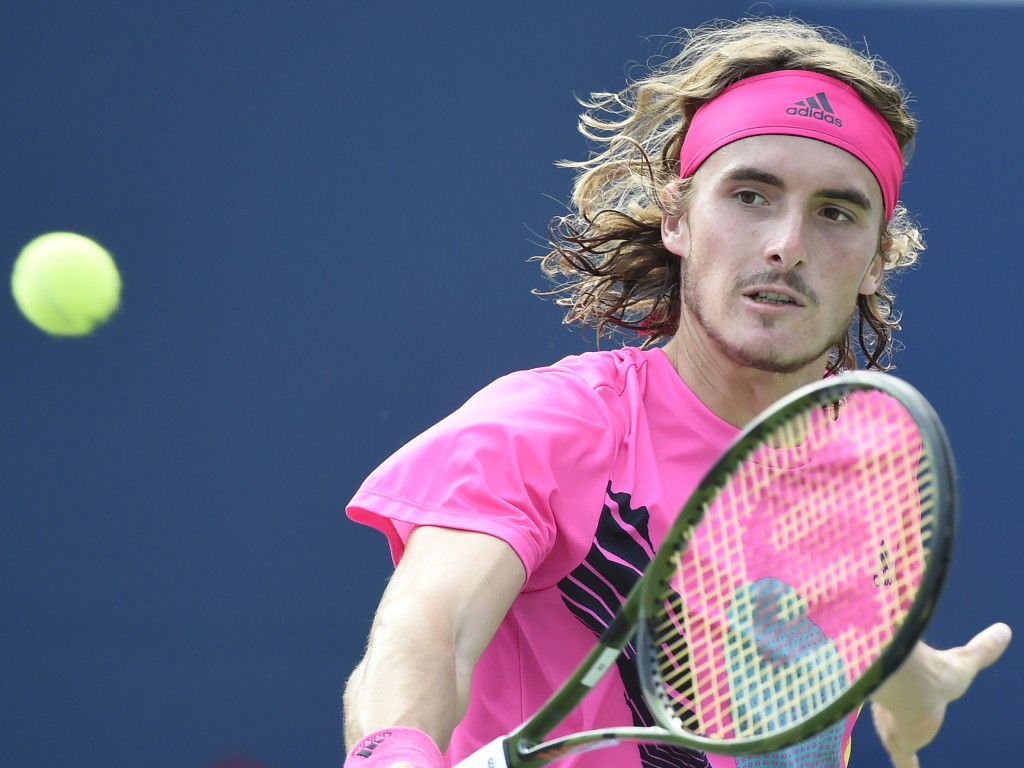 Stefanos Tsitsipas, of Greece, returns to Rafael Nadal, of Spain, during the final of the Rogers Cup men's tennis tournament in Toronto, Sunday, Aug.
