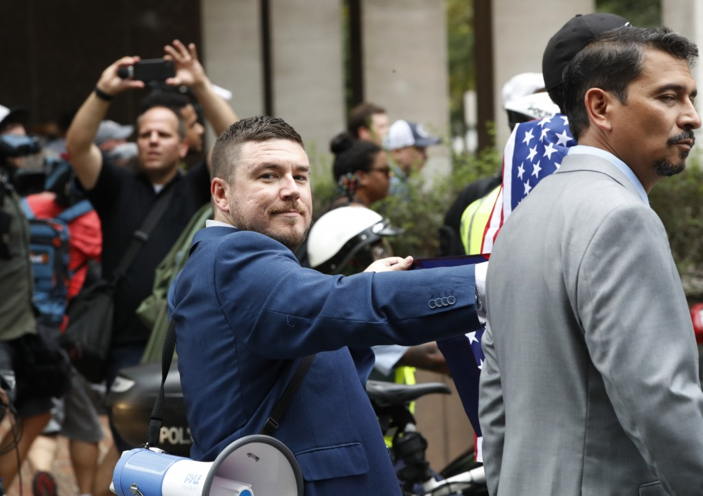 """White nationalist Jason Kessler walks to the White House to rally on the one year anniversary of the Charlottesville """"Unite the Right"""" rally, Sunday, ..."""