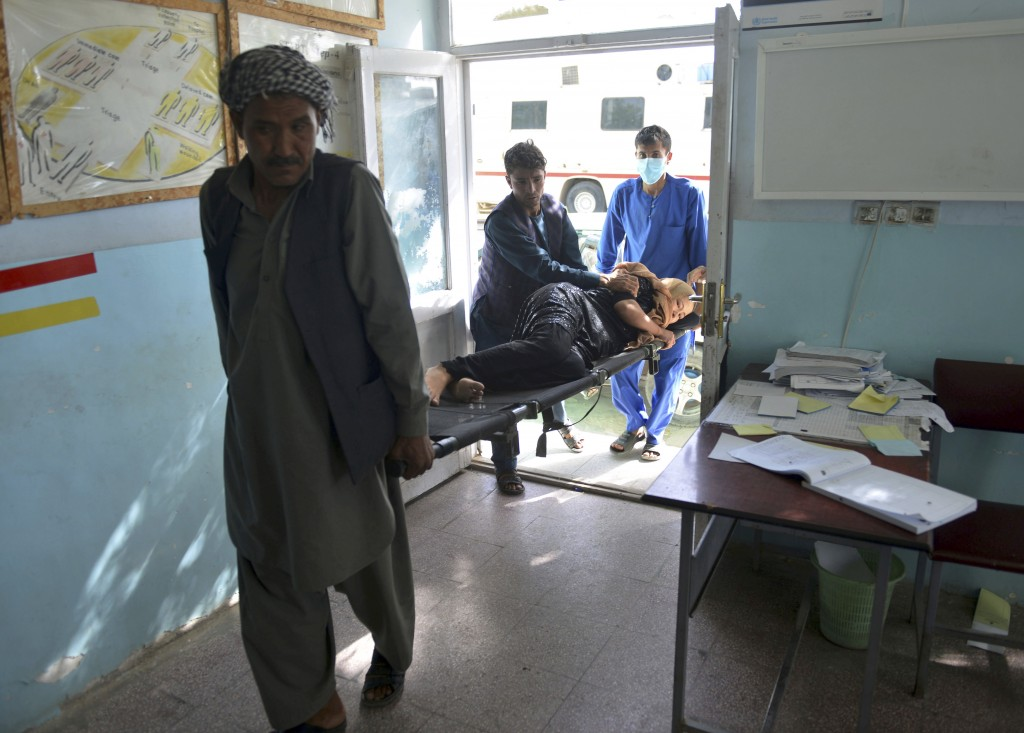 In this Sunday, Aug. 12, 2018, photo, a wounded woman is brought into a hospital in Ghazni province, west of Kabul, Afghanistan. The United States has...
