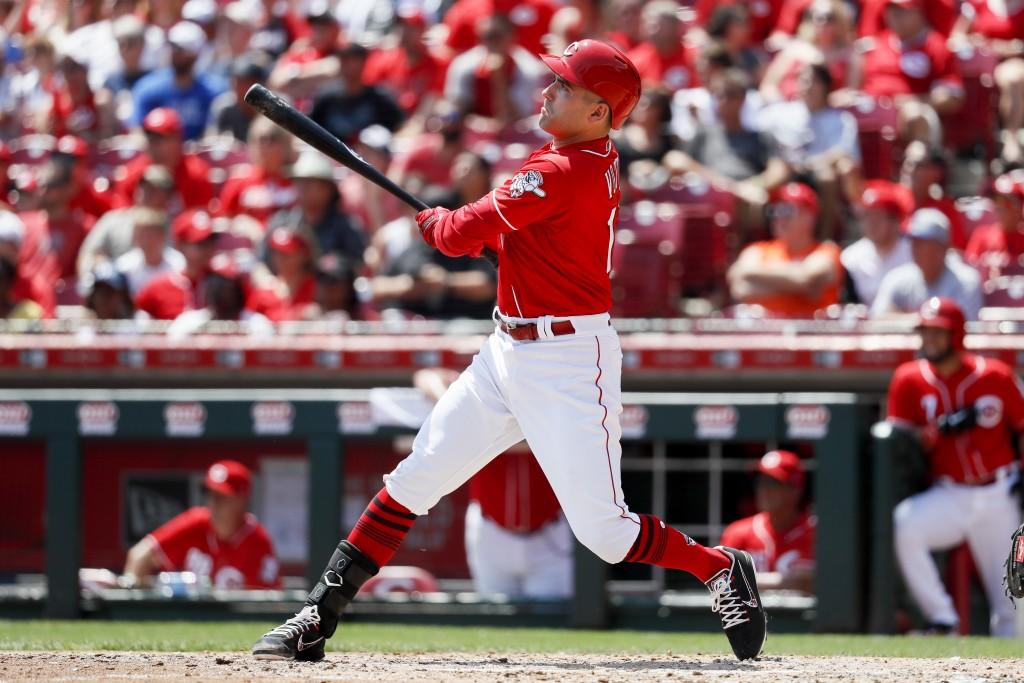 Cincinnati Reds' Joey Votto hits an RBI sacrifice fly off Arizona Diamondbacks starting pitcher Zack Godley in the third inning of a baseball game, Su