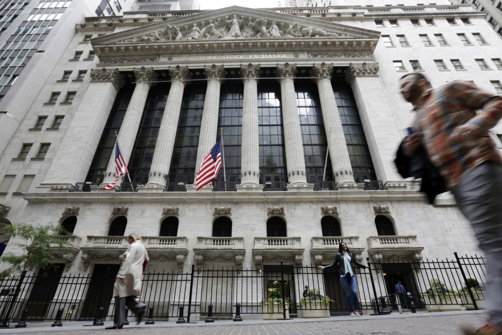 FILE - In this Oct. 24, 2017, file photo people pass the New York Stock Exchange. The U.S. stock market opens at 9:30 a.m. EDT on Monday, Aug 13. (AP ...