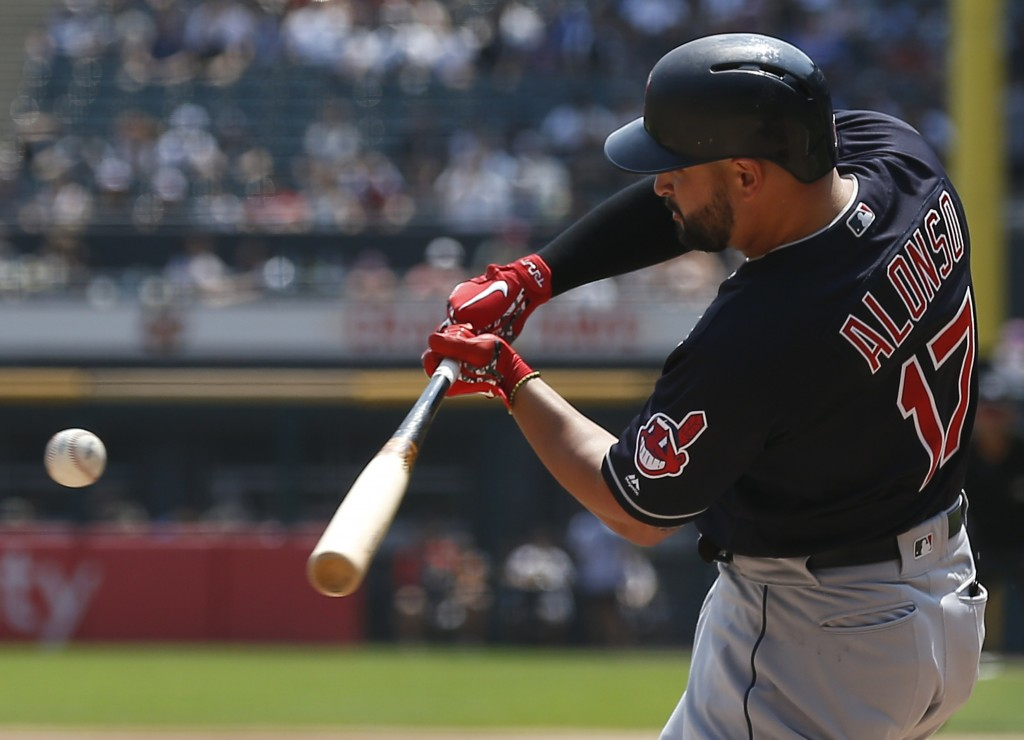 Cleveland Indians' Yonder Alonso hits an RBI single against the Chicago White Sox during the first inning of a baseball game Sunday, Aug. 12, 2018, in...