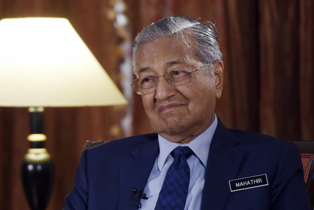 Malaysia's Prime Minister Mahathir Mohamad listens during an interview with The Associated Press in Putrajaya, Malaysia, Monday, Aug. 13, 2018. Mahath...