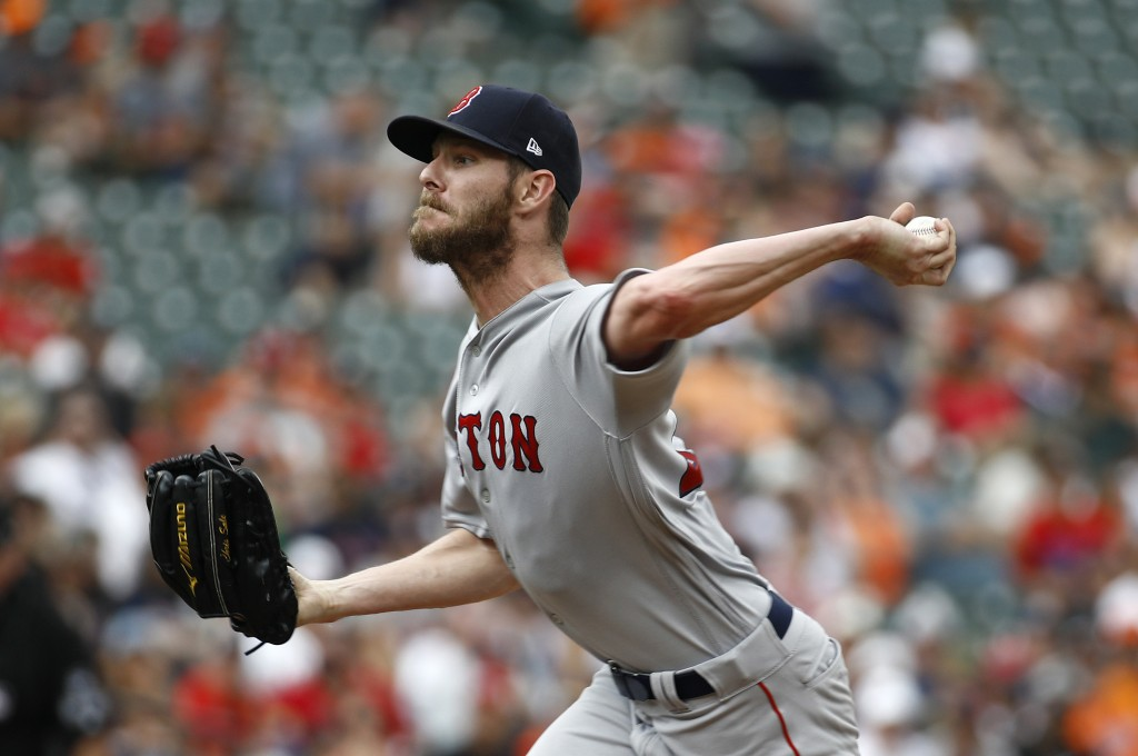 Boston Red Sox starting pitcher Chris Sale throws to the Baltimore Orioles in the second inning of a baseball game, Sunday, Aug. 12, 2018, in Baltimor