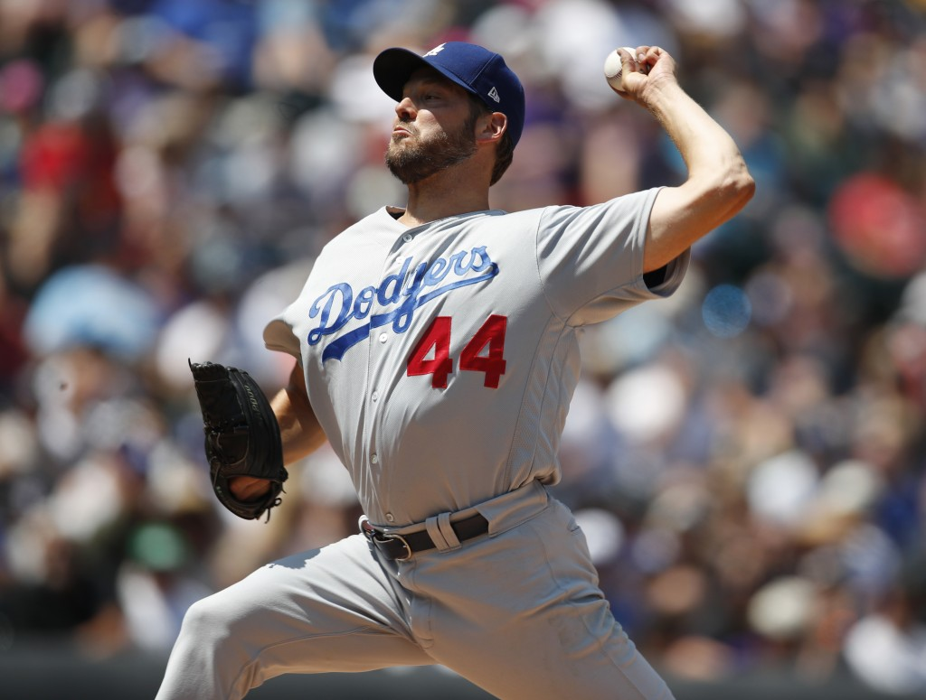 Los Angeles Dodgers starting pitcher Rich Hill works against the Colorado Rockies in the first inning of a baseball game Sunday, Aug. 12, 2018, in Den
