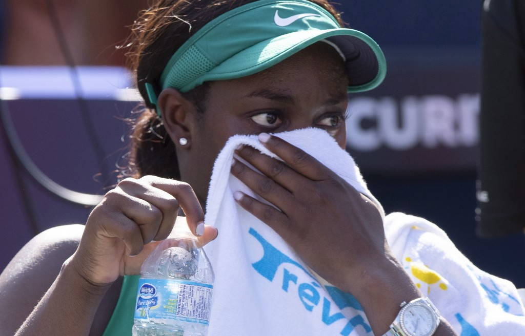 Sloane Stephens of the United States wipes her face after losing to Simona Halep of Romania in the final at the Rogers Cup tennis tournament Sunday, A