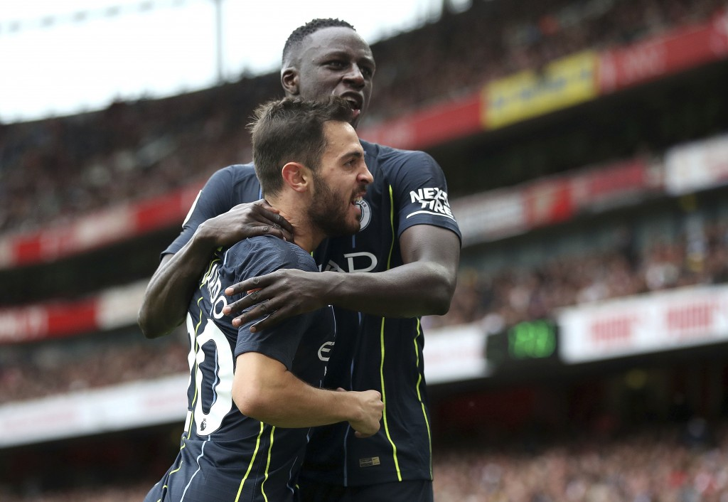 Manchester City's Bernardo Silva, left, celebrates with Benjamin Mendy after scoring his side's second goal of the game  during the English Premier Le...