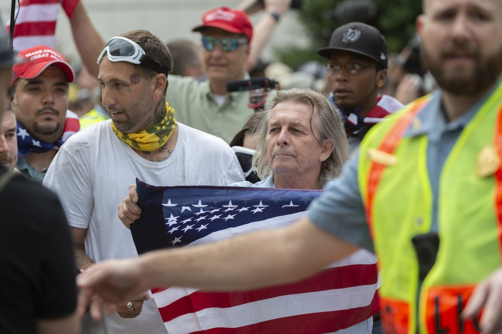 """White nationalists march to Lafayette Square during the """"Unite the Right 2"""" rally in Washington, Sunday, Aug. 12, 2018. (Craig Hudson/Charleston Gazet..."""
