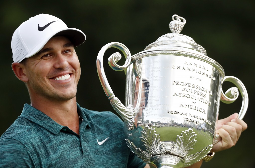Brooks Koepka holds the Wanamaker Trophy after he won the PGA Championship golf tournament at Bellerive Country Club, Sunday, Aug. 12, 2018, in St. Lo...