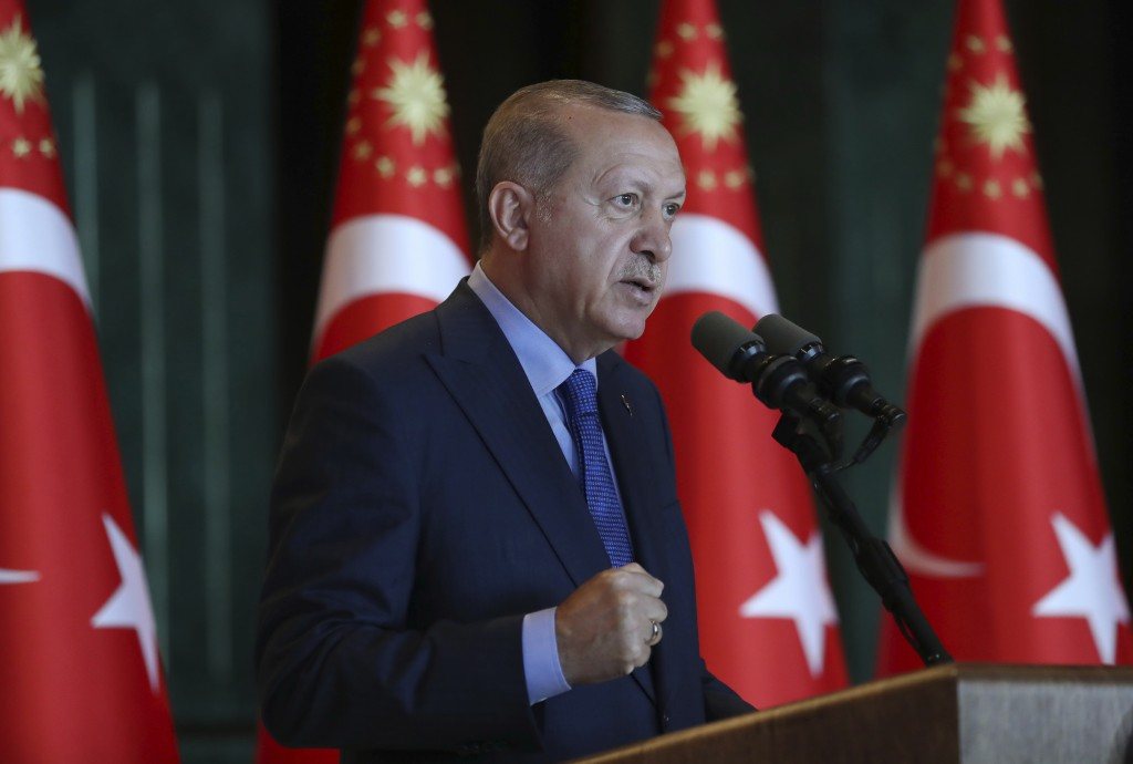 Turkey's President Recep Tayyip Erdogan, gestures as he delivers a speech to Turkish ambassadors at the Presidential Palace in Turkey, Monday, Aug. 13...