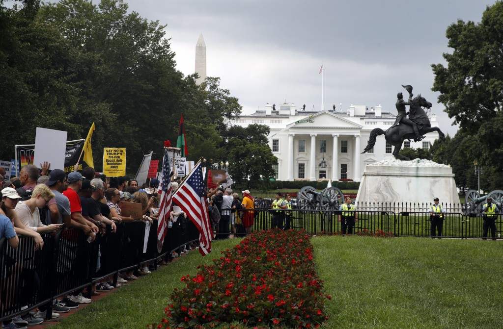 """Demonstrators rally near the White House on the one year anniversary of the Charlottesville """"Unite the Right"""" rally, Sunday, Aug. 12, 2018, in Washing..."""