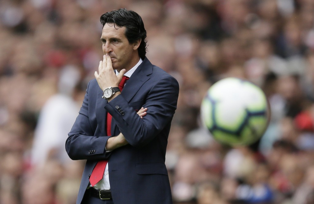 Arsenal manager Unai Emery watches from the sidelines during the English Premier League soccer match between Arsenal and Manchester City at the Emirat...