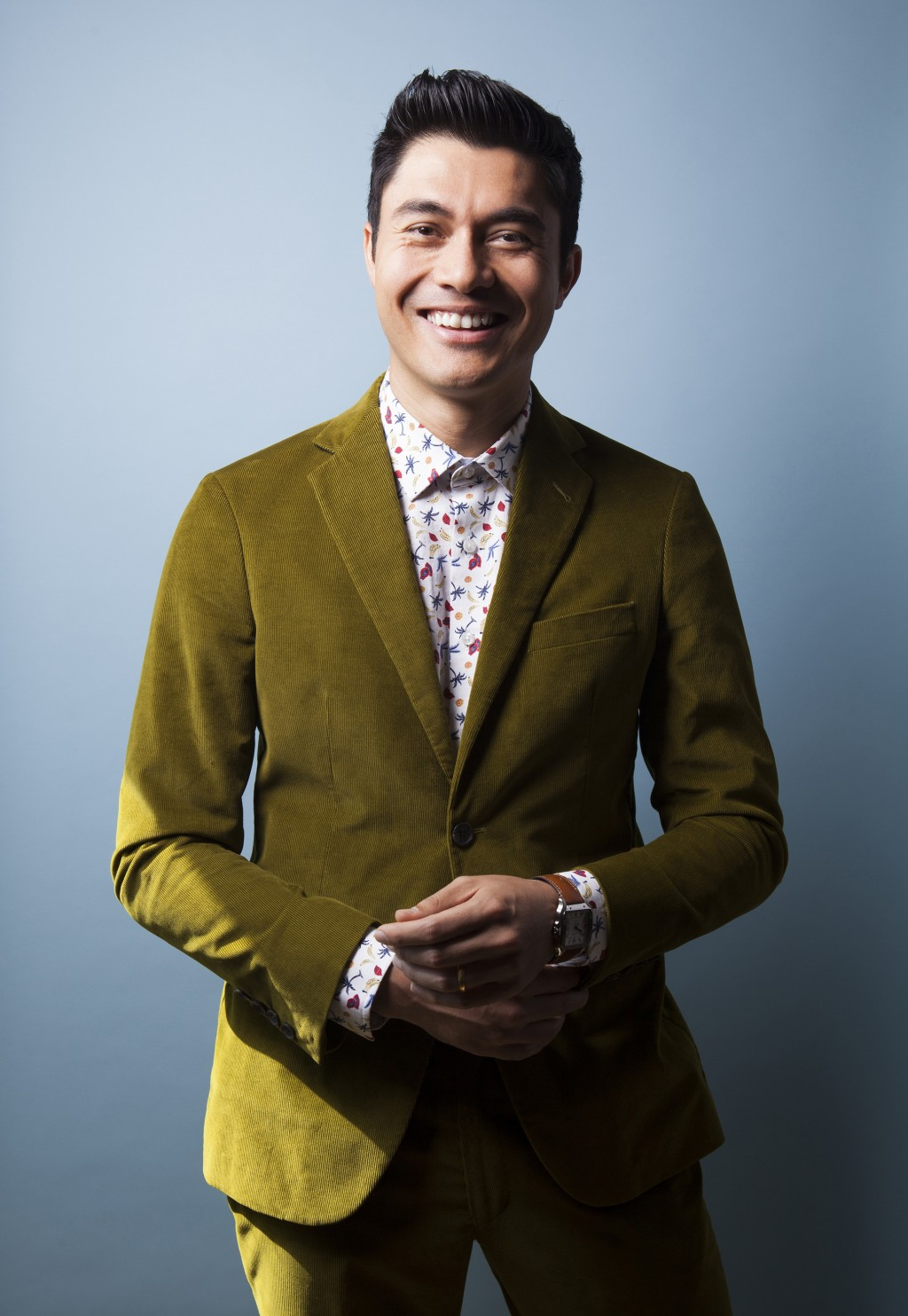 """In this Aug 4, 2018 photo, actor Henry Golding poses for a portrait at the Beverly Wilshire Hotel in Beverly Hills, Calif. to promote his film """"Crazy ..."""