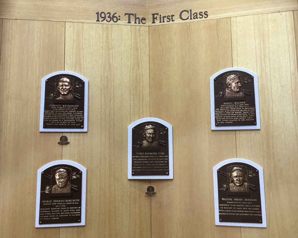 In this July 16, 2018 photo, baseball greats from the first class inducted into National Baseball Hall of Fame are honored in the Plaque Gallery at th...