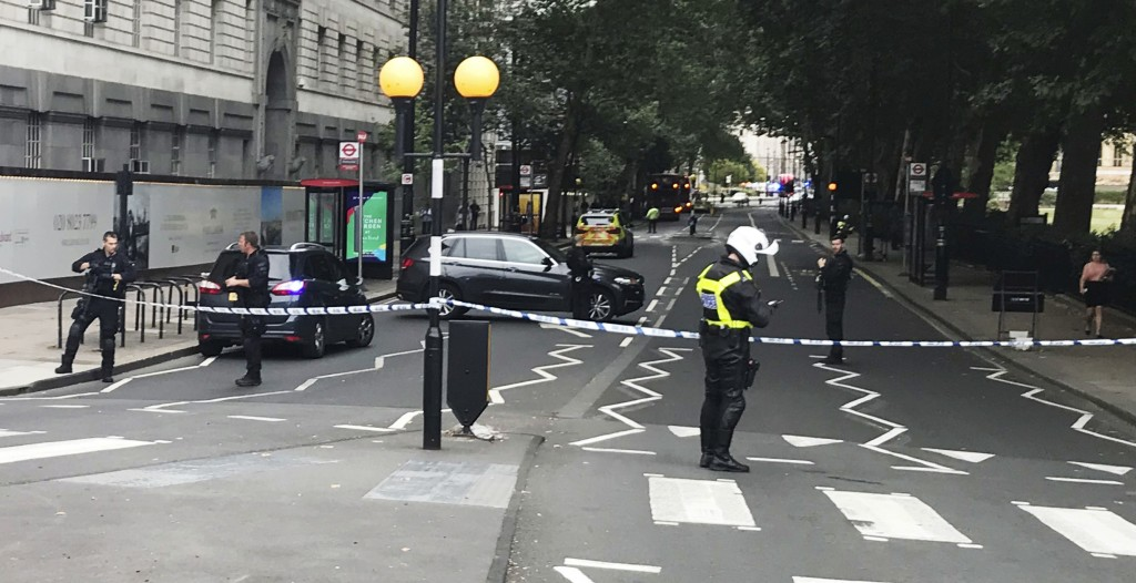 Police patrol on Millbank, in central London, after a car crashed into security barriers outside the Houses of Parliament, in London,  Tuesday, Aug. 1...