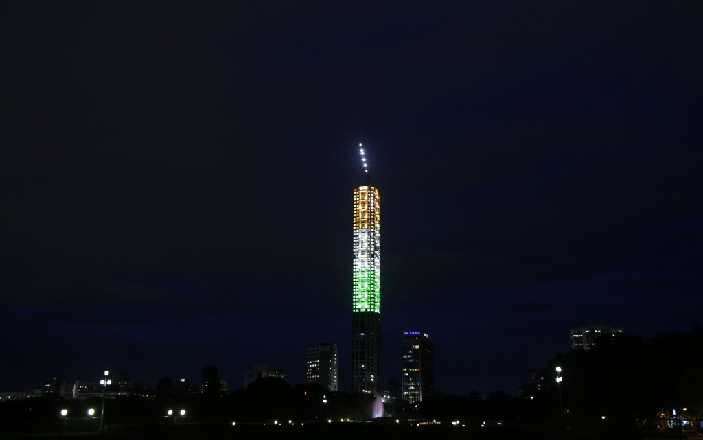 A high rise building is illuminated in the colors of the Indian tricolor flag on the eve of Independence Day in Kolkata, India, Tuesday, Aug. 14, 2018...