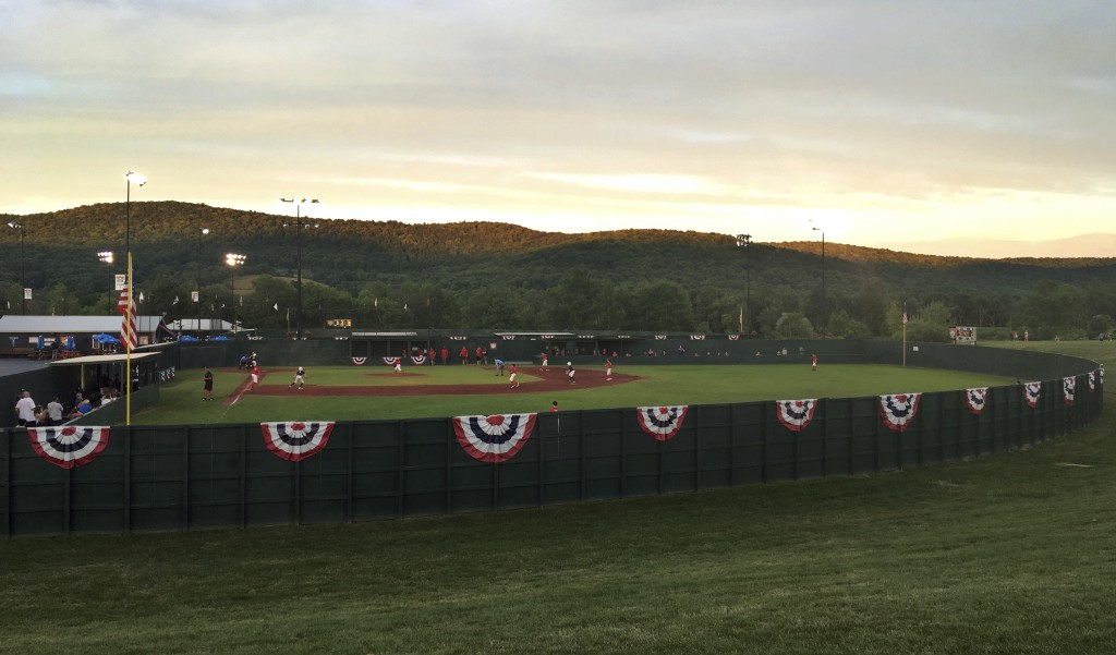 In this July 17, 2018 photo, an evening baseball game is played at Cooperstown Dreams Park in Hartwick Seminary, N.Y., about four miles from the great...