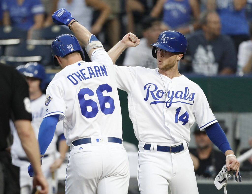 Kansas City Royals' Ryan O'Hearn (66) is congratulated by Brett Phillips (14) after hitting a two-run home run in the second inning of a baseball game...