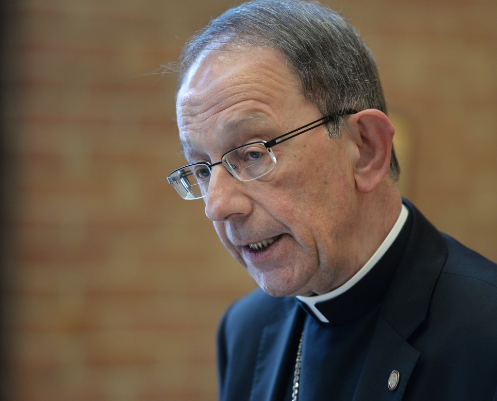 FILE - In this Friday, April 6, 2018, file photo, Catholic Diocese of Erie Bishop Lawrence Persico conducts a news conference in Erie, Pa. Time is tic...