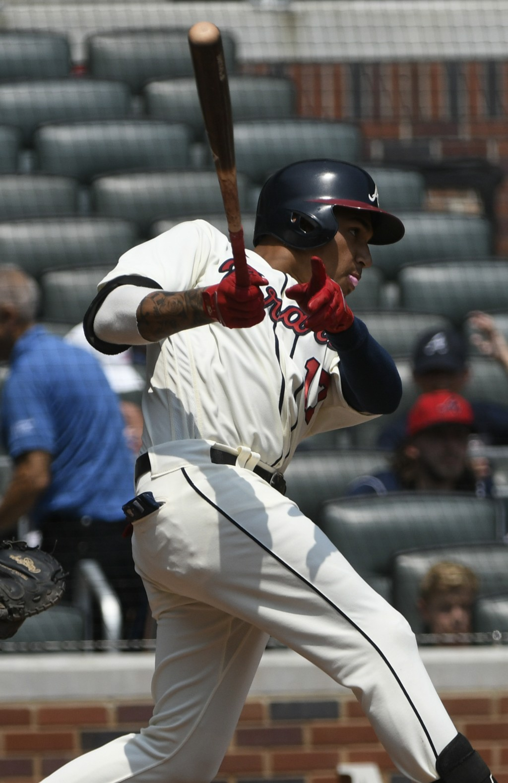 Atlanta Braves' Johan Camargo hits a double to left field for an RBI during the fourth inning of the first game in a baseball doubleheader against the...