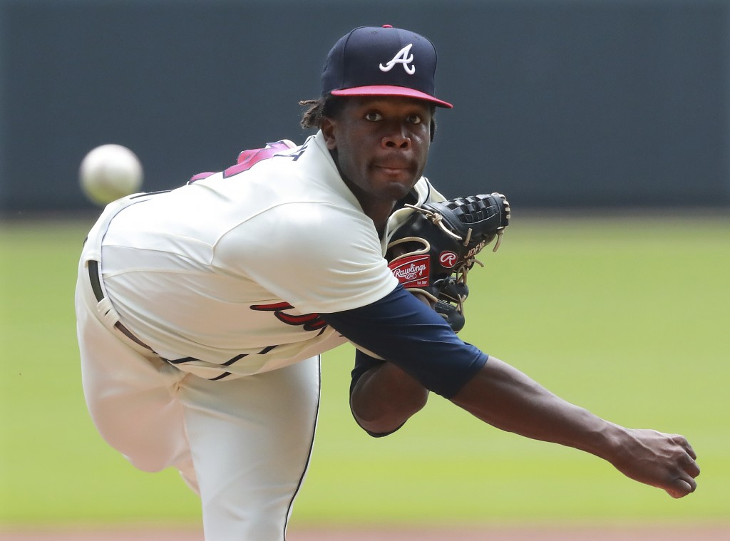 Atlanta Braves Touki Toussaint, making his MLB debut, delivers a pitch against the Miami Marlins during the first inning of a baseball game on Monday,...