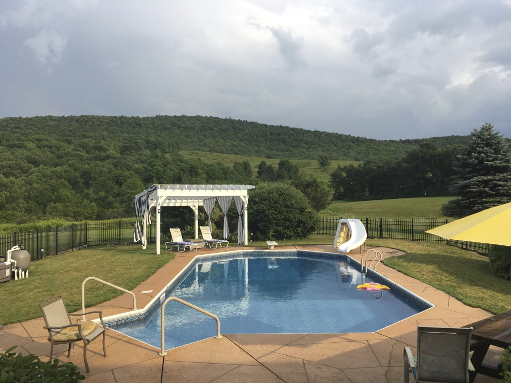 This July 14, 2018 photo shows the views of rolling hills and forest from the deck of the house the writer's family stayed in during their visit to Co...