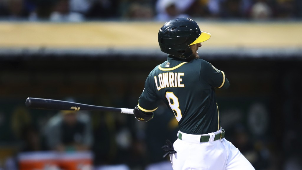 Oakland Athletics' Jed Lowrie swings for a two run double off Seattle Mariners' Marco Gonzales in the third inning of a baseball game Monday, Aug. 13,...