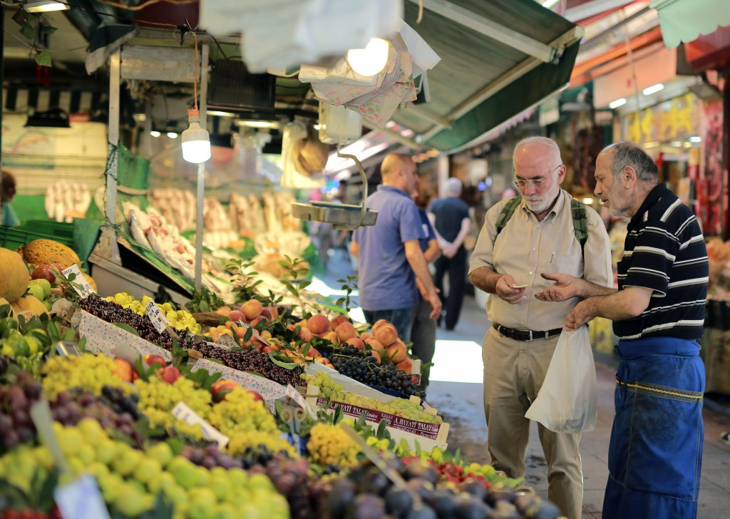 A man shops in a market in Istanbul, Monday, Aug. 13, 2018. Turkey's central bank announced a series of measures on Monday to free up cash for banks a...