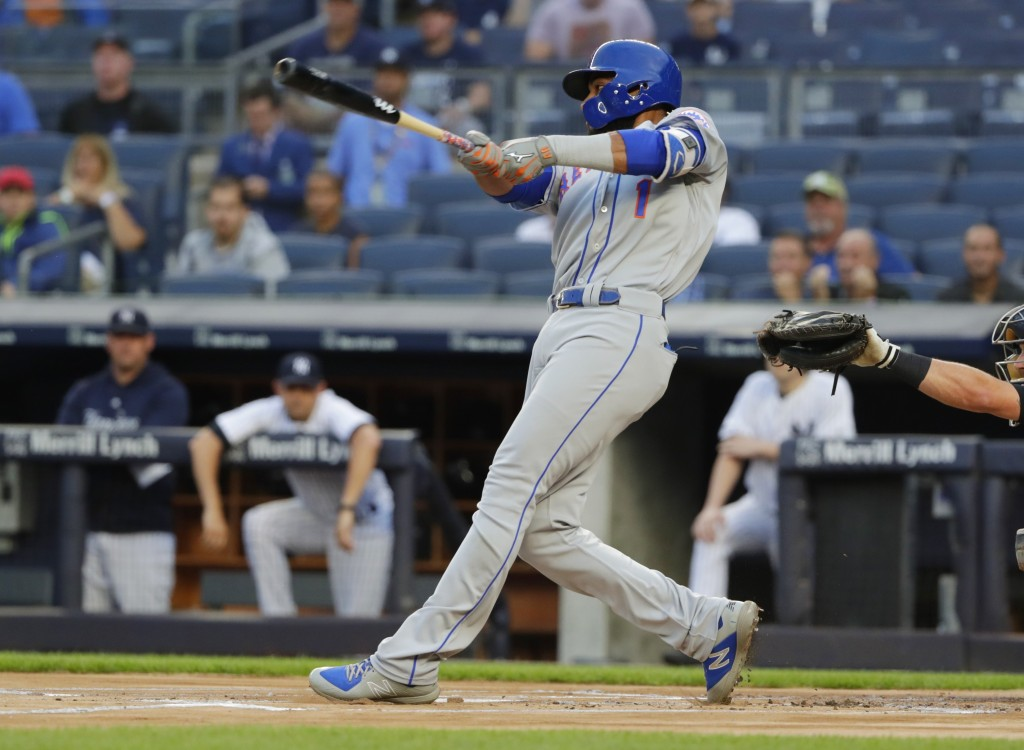 New York Mets' Amed Rosario hits a home run during the first inning of a baseball game against the New York Yankees Monday, Aug. 13, 2018, in New York...