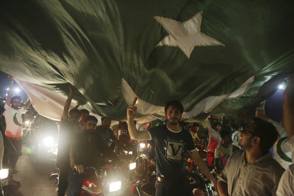 People celebrate to mark the country's Independence Day in Lahore, Pakistan, Tuesday, Aug 14, 2018. Millions of Pakistanis celebrate the 71st Independ...