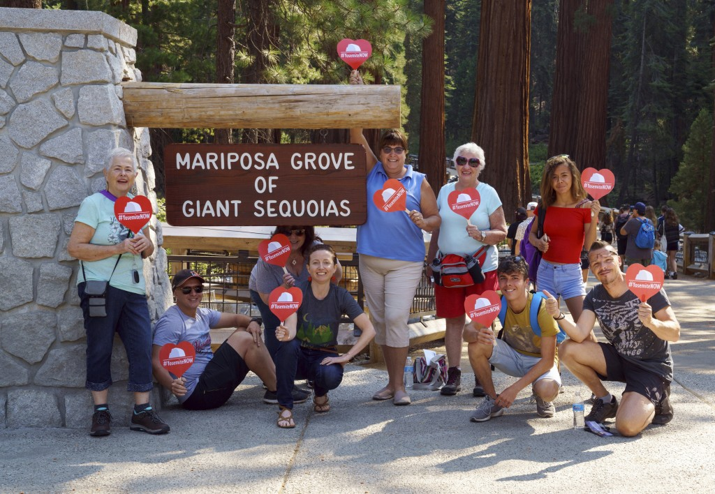 This photo provided by Visit Yosemite, Madera County Visitors Bureau, shows Yosemite National Park employees, and a few visitors from France, posing f...