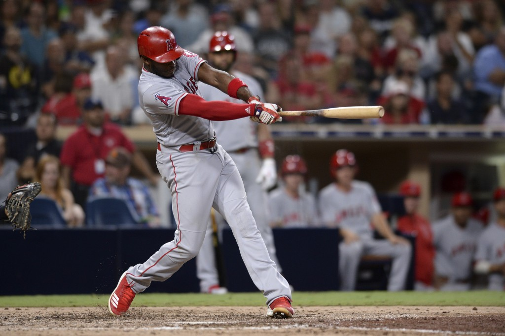 Los Angeles Angels' Justin Upton hits a two-run home run during the 10th inning of a baseball game against the San Diego Padres, Monday, Aug. 13, 2018...