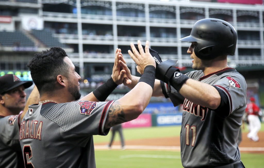 Arizona Diamondbacks A.J. Pollock (11) is congratulated by David Peralta (6) after scoring on an RBI double hit by Steven Souza Jr.,not pictured, duri...