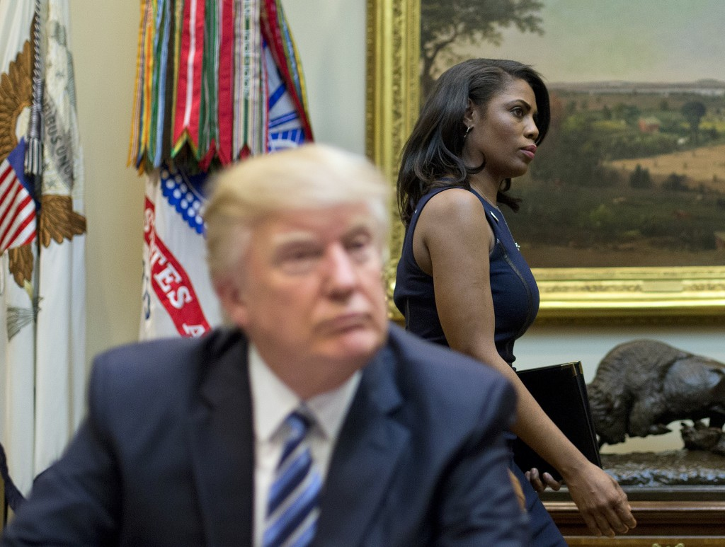 FILE - In this March 12, 2017 file photo, White House Director of communications for the Office of Public Liaison Omarosa Manigault, right, walks past...