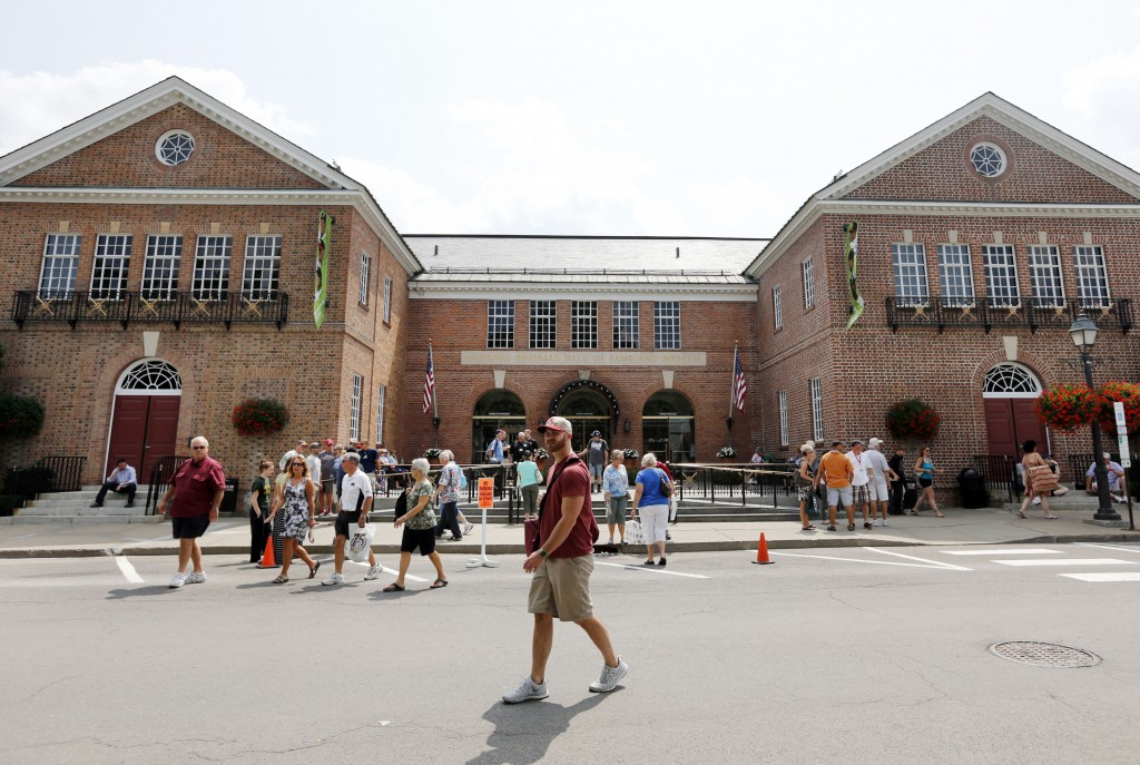FILE - In this July 25, 2014, file photo, fans walk outside the National Baseball Hall of Fame, in Cooperstown, N.Y. There's much more to the one-stop...