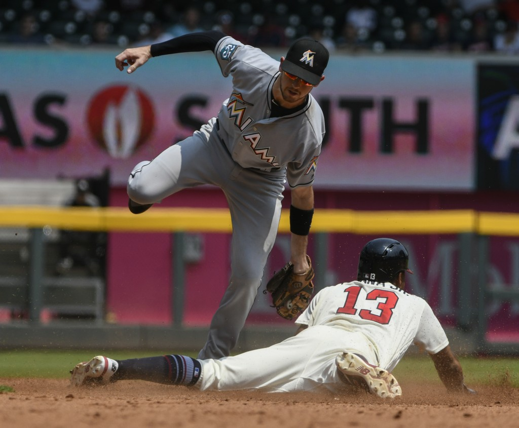 Atlanta Braves' Ronald Acuna Jr. (13) steals second base as Miami Marlins shortstop JT Riddle comes down from a high throw and late tag during the fif...