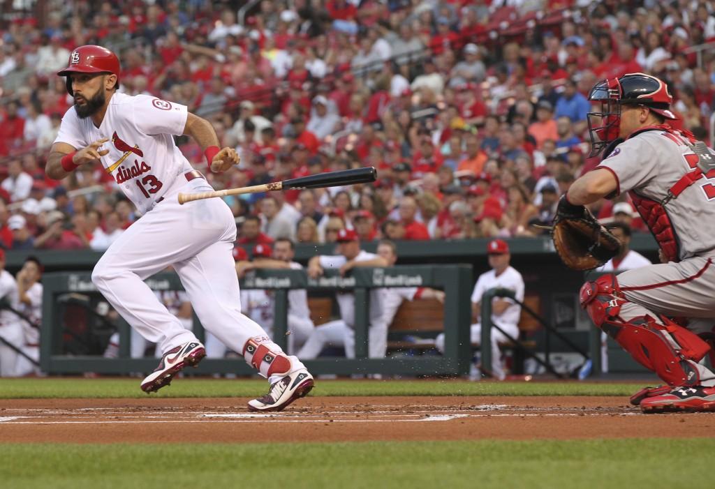 St. Louis Cardinals' Matt Carpenter (13) drops his bat after bunting as Washington Nationals catcher Matt Wieters looks on in the first inning of a ba...