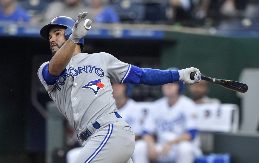 Toronto Blue Jays' Devon Travis follows through on a solo home run in the first inning of a baseball game against the Kansas City Royals on Monday, Au...