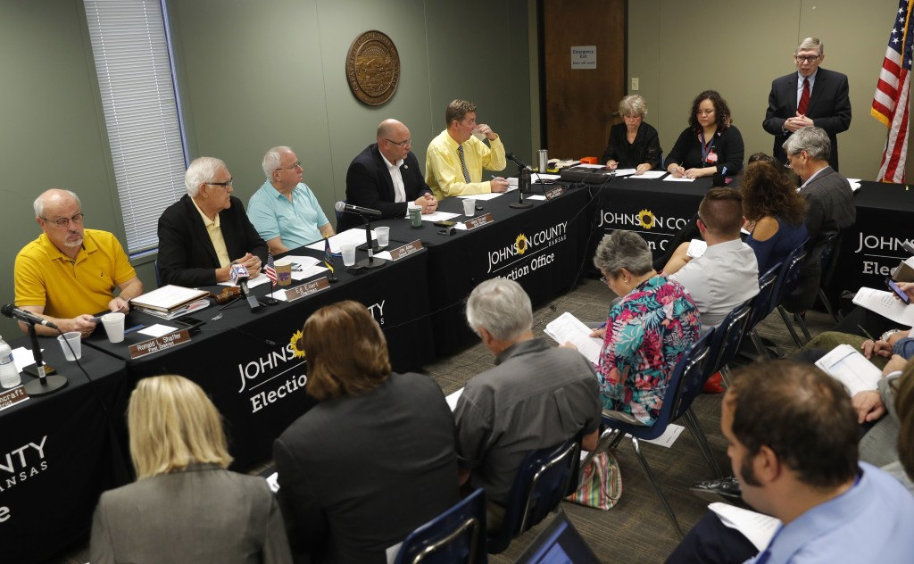 Johnson County chief council Don Jarrett speaks during the Johnson County Board of Canvassers meeting, Monday, Aug. 13, 2018, in Olathe, Kan. County e...