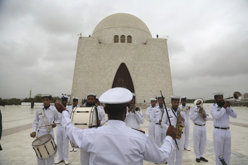 Soldiers of Pakistan Navy play the national anthem at the mausoleum of Muhammad Ali Jinnah, founder of Pakistan, to celebrate the 71st Independence Da...