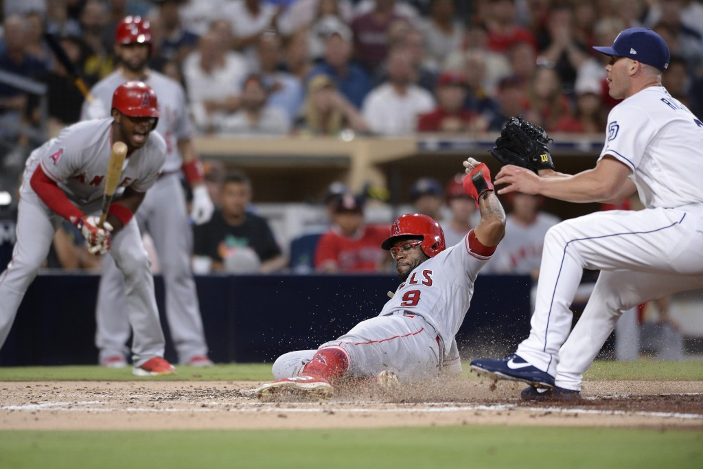 Los Angeles Angels' Eric Young Jr. (9) slides home ahead of the throw on a wild pitch during the third inning of a baseball game against the San Diego...