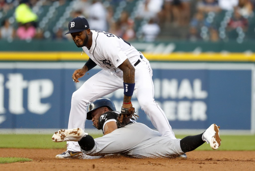 Detroit Tigers second baseman Niko Goodrum tags Chicago White Sox's Yoan Moncada out attempting to steal second base in the fourth inning of a basebal...